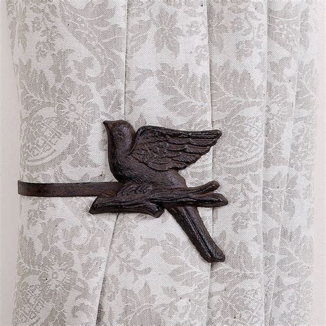 set of two cast iron birds on a branch tie back by dibor