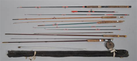 collection  fishing rods  include wilkinsons special split cane fly rod   fibre glass
