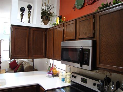 Restaining Oak Cabinets by The Ideas Of Decorating Kitchen With Two Tone Kitchen