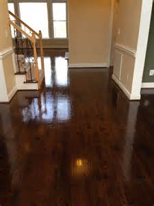 oak hardwood floors after three coats of polyurethane gloss mix of minwax walnut