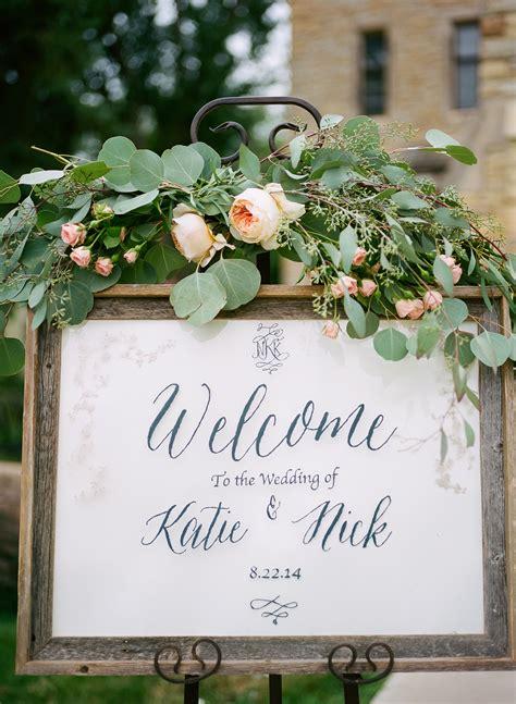 diy framed welcome sign with eucalyptus and garden decor wedding