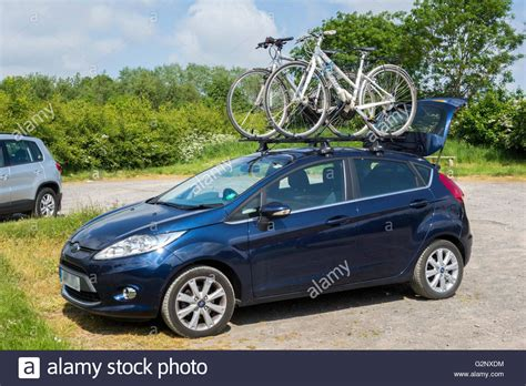ford fiesta car carrying  bikes   roof rack stock