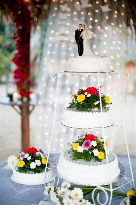separated tier wedding cake  bright flowers