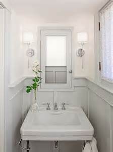 small powder bathroom ideas bathrooms chrome sconces fixtures gray wainscoting gray