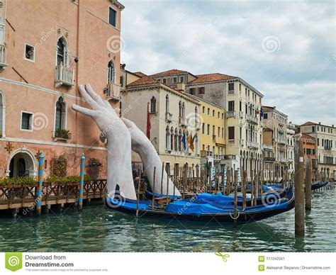 Giant White Hands Rise From A Water Venice Italy