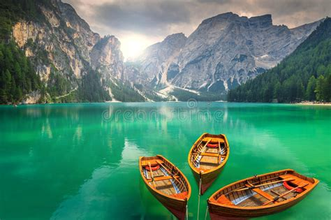 Stunning Mountain Lake With Wooden Boats In The Dolomites