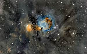 APOD: 2014 March 25 - Orion Nebula in Surrounding Dust