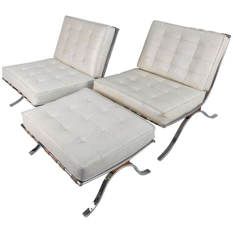 pair of vintage modern barcelona style lounge chairs by