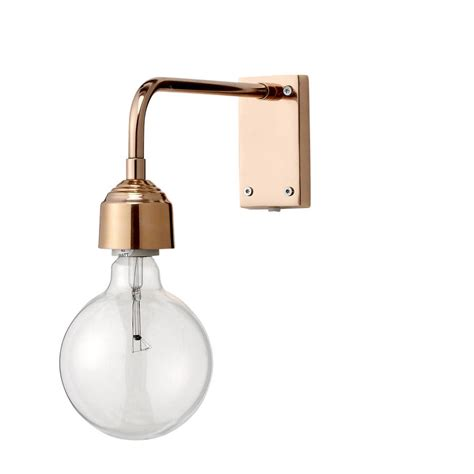 copper or brass wall light by the forest co