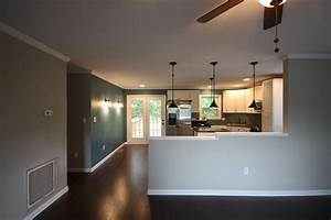 half walls in living room living room With kitchen colors with white cabinets with paper towel wall art