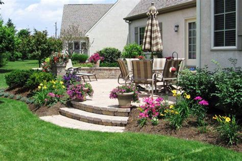 landscaping patio ideas idea for solving our problem of such a steep drop off with steps down into fire pit backyard
