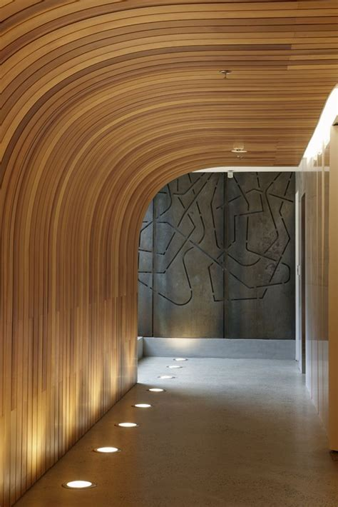 wood ceiling curved  lighting corridor design
