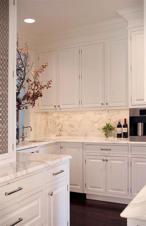white kitchen  calcutta gold marble backsplash