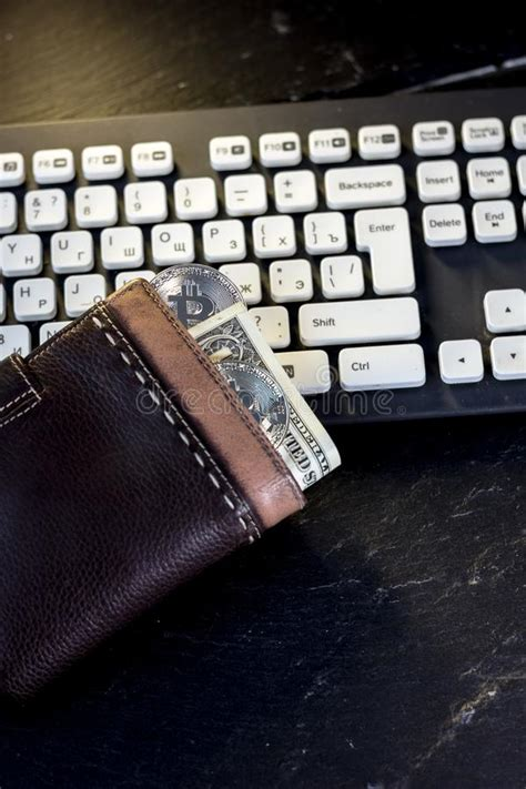 Your bitcoin and bitcoin cash address will change each time you request but your ether address will stay the same. Wallet With Cash And Bitcoin Coin Over The Computer Keyboard. Stock Image - Image of electronic ...