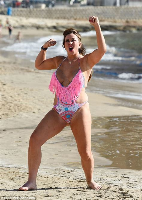 lisa swimsuit lisa appleton salutes the sun in a low cut swimsuit