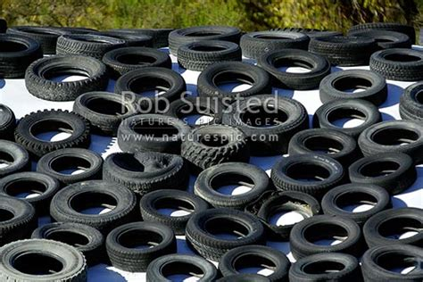 Old Rubber Car Tyres Laid Out In Pattern. Rubbish, Waste