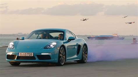 718 Hd Picture by The Porsche 718 Cayman S Race A Swarm Of Drones