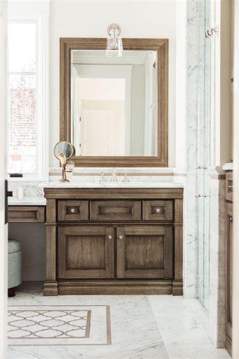 custom bath vanity  dark wood grain marble countertop