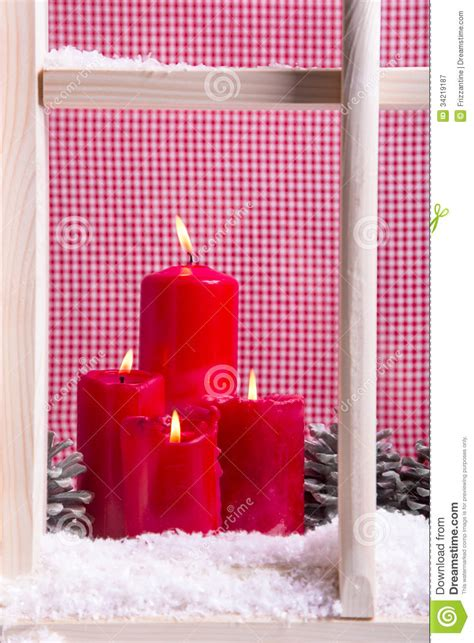 indoor christmas window sill decoration  red candles