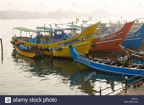 Kerala Fishing Boat For Sale by Brightly Coloured Fishing Boats Moored At Sunrise Fort