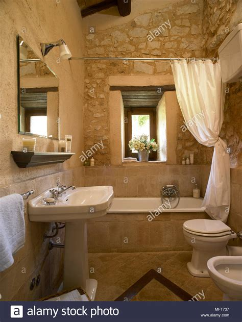 Bathroom With Stone Wall A Team Residential Remodeling