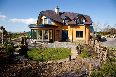 This Cob house is as beautiful as its making