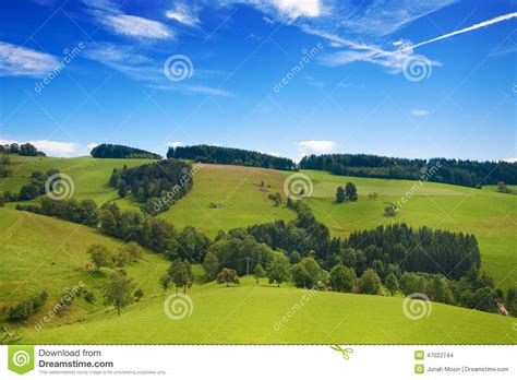 Rolling Green Hills Of Germany With Blue Sky Stock Photo