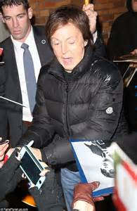 Sir Paul McCartney is mobbed by fans as he leaves Daily ...