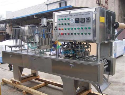 rotary cup filling  sealing machine  dual cups manufacturers exporters gujarat india