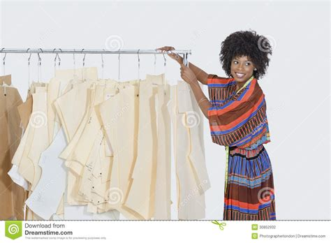 Standing Clothing Rack by African American Female Designer With Sewing Patterns On