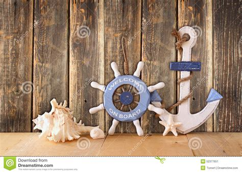 nautical wood wheel anchor  shells  wooden table