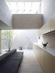maison blockhaus par suppose design office With puit de lumiere maison