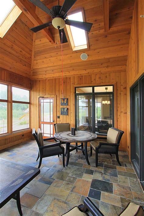 knotty pine sun room  slate floors home design ideas