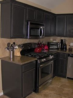 warm gray kitchen cabinets warm grey cabinets and granite countertop for the home 7001