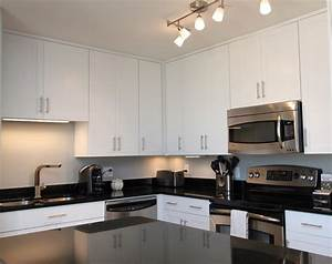 White contemporary kitchen with brushed nickel hardware for Kitchen colors with white cabinets with brushed nickel wall art