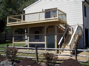 how to use your under deck patio salter spiral stair With under deck dog kennel