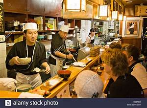 Cooks serving food inside a Japanese restaurant in Kyoto Japan Stock Photo - Alamy