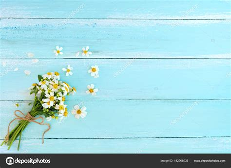 beautiful bouquet white wildflowers blue wooden background