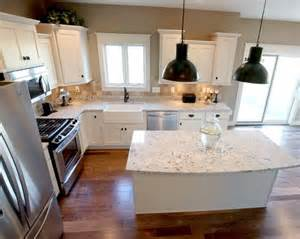 l shaped kitchen island l shaped kitchen layout with an arched overhang on the island photo by applestone homes
