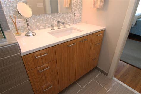 vanity  white countertop  mosaic glass tile