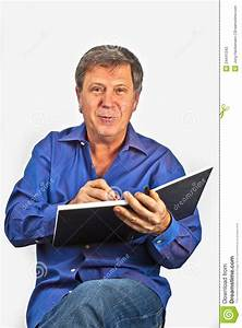 Man Writing In A Book Stock Photography - Image: 24441242