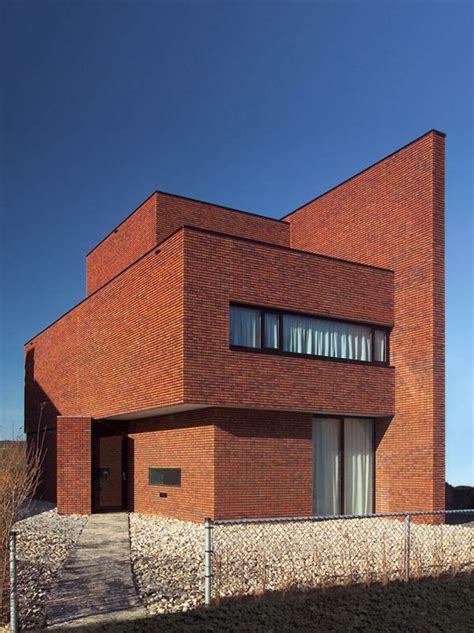 brick wall house boasts minimalist style  maximum