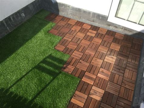 roof terrace with ikea decking tiles and oakham artificial