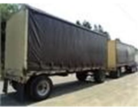 2003 reliance curtain side doubles flatbed trailer for