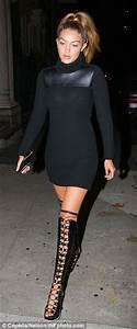 Bella Hadid flashes her bra as Gigi puts on a leggy ...