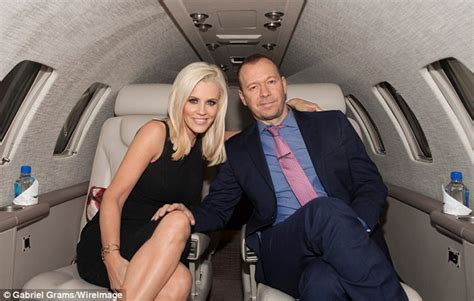 jenny mccarthy  donnie wahlberg kiss  launch  jetsmarter private jet app daily mail