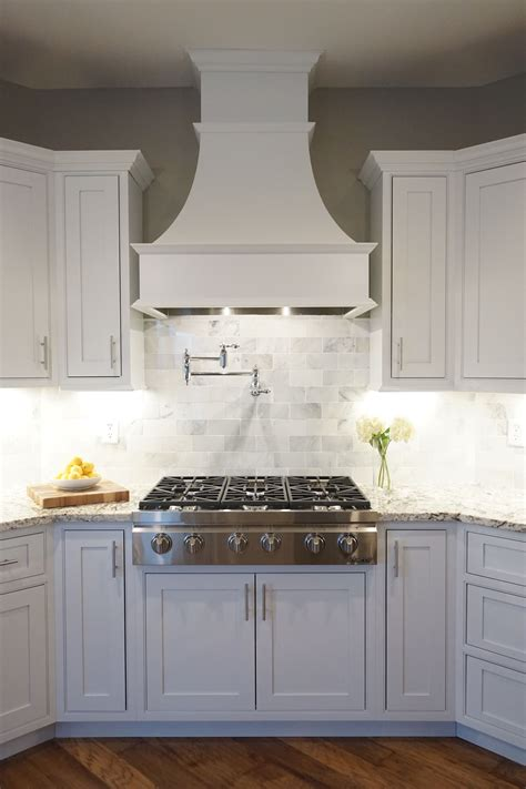 kitchen range cabinet white cabinets shaker door inset cabinetry decorative