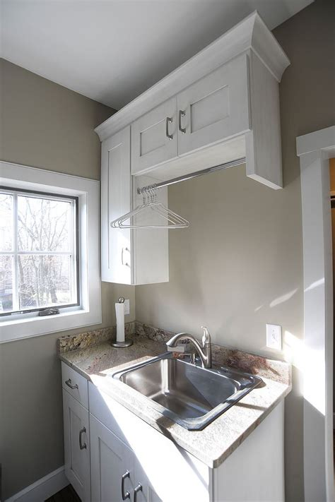 laundry room  hanging rod  sink  drips