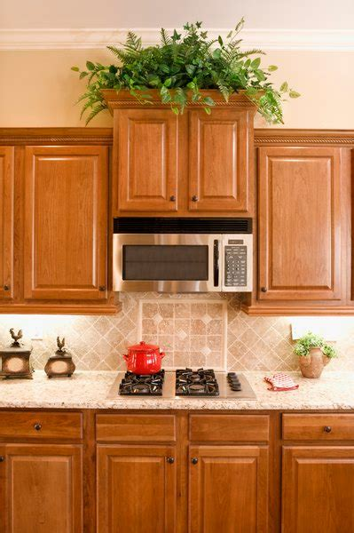 Their classic design makes them an. what to decorate above kitchen cabinets in 2020 | Above ...