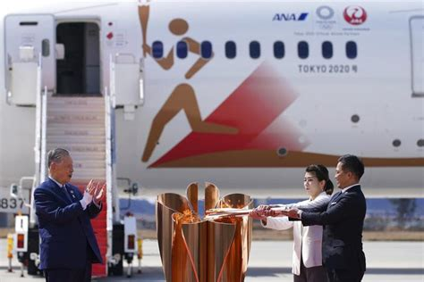 virus concerns overshadow olympic flame arrival  japan sports china daily